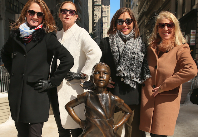 Four female board members from a top retailer with brands such as Ann Taylor and Justice posed for a photograph in hopes of sending a strong message to Corporate America – put more women on boards.